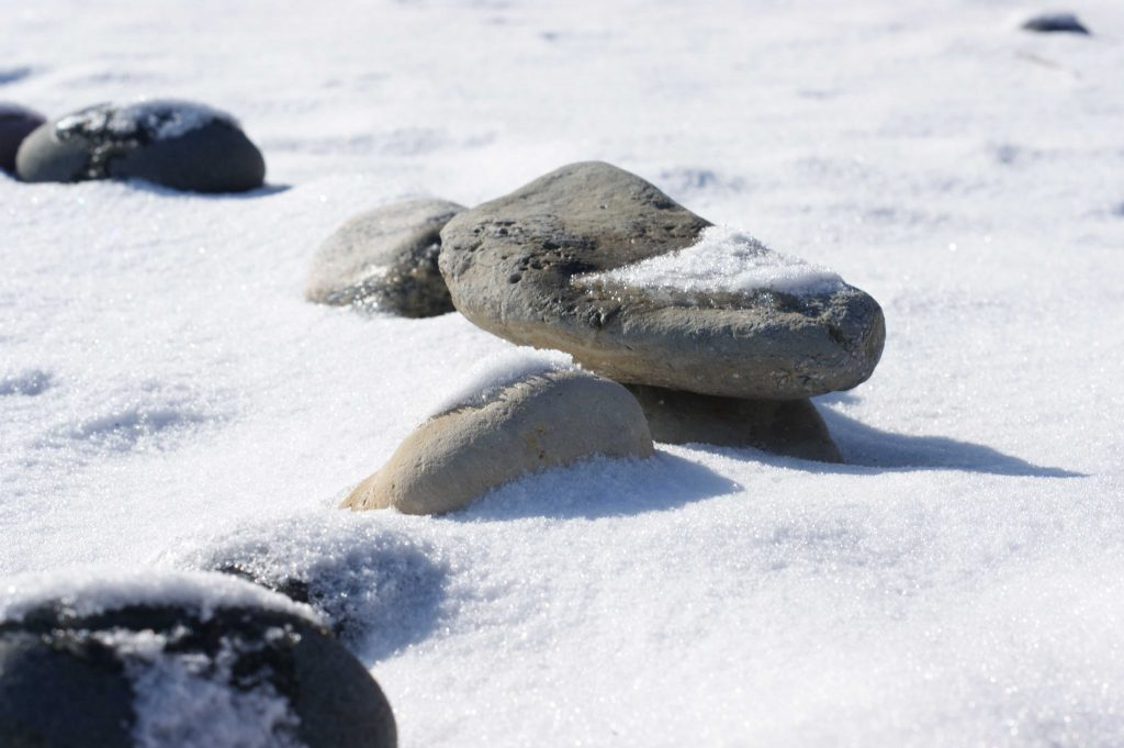 Lake stones covered in snow